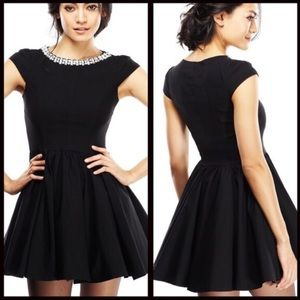 Little black dress with jeweled collar